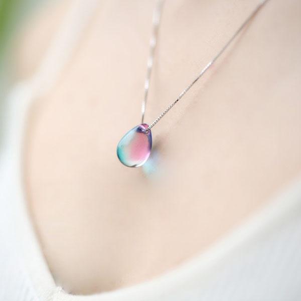 Tear drop color changing pendant necklace black cord